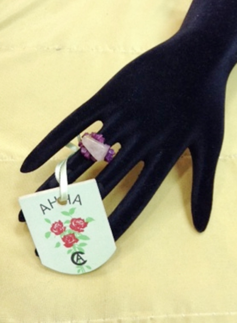 Ring of pink quartz and other natural stones